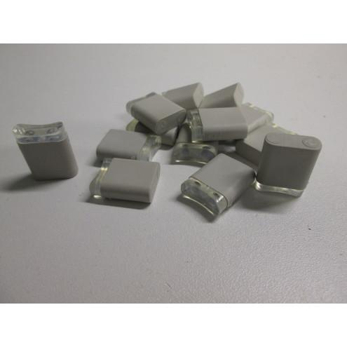 Tampon pour glissière de frein